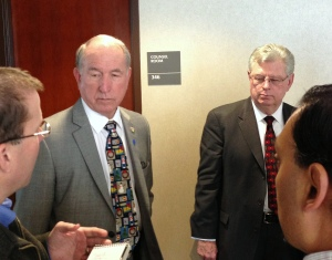 San Bernardino Mayor Patrick Morris, left, and City Attorney James Penman talk to reporters