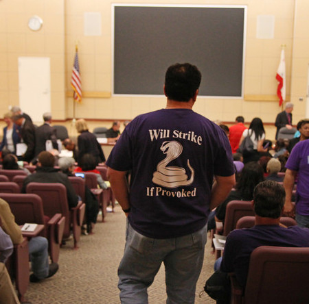 One of several strike warning shirts and jackets at panel hearing (San Jose Mercury-News photo)